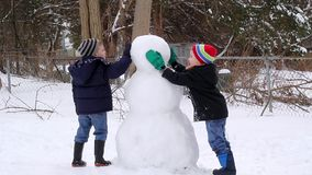 Children Making a Snowman stock video