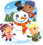 Children making a snowman in winter Royalty Free Stock Photography