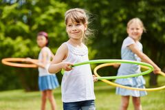 Children making sport with hoops. At the park stock photography