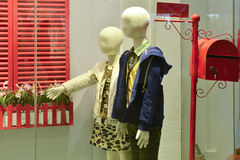 Children mannequins in  Clothing shop window Stock Image