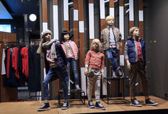 Children Mannequins In Warm Clothes In The Shop Windowow. Sale Royalty Free Stock Photography