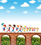 Children marching on the bridge Royalty Free Stock Photo