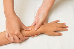 Children massage with morther hand Stock Image