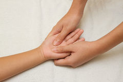 Children massage with mother hand Stock Images