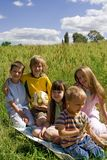 Children on meadow Stock Photo