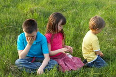 Children in a meadow Royalty Free Stock Image