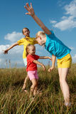 Children on a meadow Stock Photos