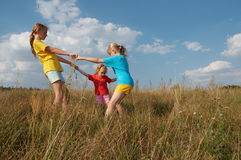 Children on a meadow Stock Photos