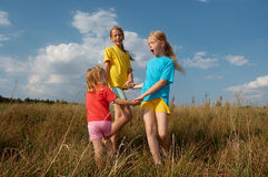 Children on a meadow Stock Images