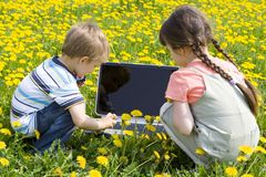 Children on meadow Stock Photos