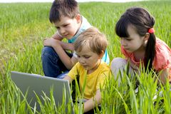 Children on meadow Stock Images