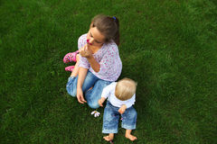 Children in the meadow. Family Stock Photos