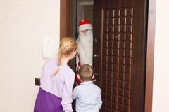 Children meet Santa Claus. Children in the apartment meet Santa Claus on New Year`s night stock image