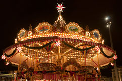 Children Merry-go-round at Christmas Market Stock Image