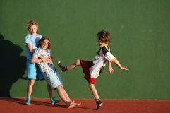 Children messing about. Lifestyle image of three children Royalty Free Stock Photos