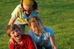 Children messing about in park. Natural group portrait of children in park Stock Photos