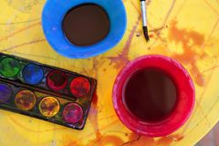 Children messy dirty student watercolor table Royalty Free Stock Image