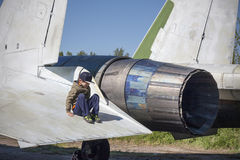 Children in military. Boy plays on fighter wing. Stock Images