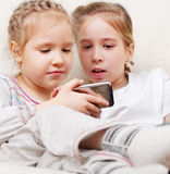 Children with mobile phone Royalty Free Stock Photos
