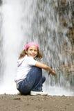 Children mode 4. Girl posing at the falls Royalty Free Stock Photo