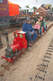 Children on model steam railway Stock Photo