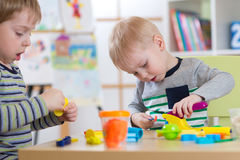 Children modeling in preschool or daycare center. Children hands working in preschool or daycare center royalty free stock photos