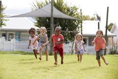 Children At Montessori School Having Fun Outdoors During Break Royalty Free Stock Photography