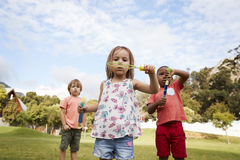 Children At Montessori School Playing With Bubbles During Break Royalty Free Stock Photo