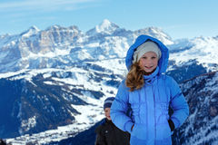 Children on winter  mountain background. Gardena Pass, Italy. Royalty Free Stock Images