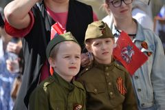 Russian kids in military outfit Royalty Free Stock Photos