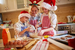 Children and mother baking cookies at home Stock Photography