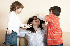 Children and mother playing Stock Photography