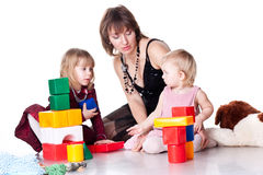 Children with mother playing with blocks Royalty Free Stock Photo