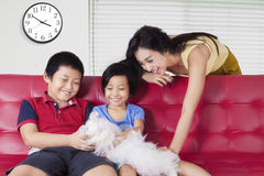 Children and mother playing dog Royalty Free Stock Images