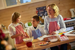 Children and mother preparing Christmas cookies. Children and mother preparing  cookies- time Stock Photography