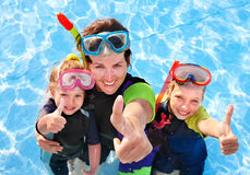 Children with mother  in swimming pool. Children with mother  in swimming pool learning snorkeling Stock Photos