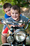 Children on a motorcycle royalty free stock photos