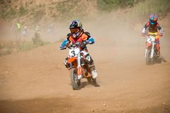 Children motorcycle racer. MOSCOW, RUSSIA - SEPTEMBER 15, 2018: Unrecognized young athletes,in the Velyaminovo Race Weekend 2018, Motopark Velyaminovo, Istrinsky royalty free stock photos