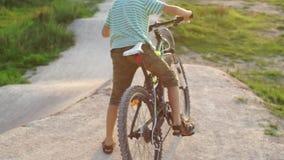Children mountain biking downhill, bike school. Children mountain biking downhill, bicycle school, riding down stock video