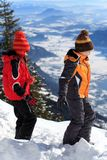 Children on mountain slope. Two young children walking in snow on the slope of a steep mountain Stock Photography