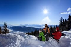 Children in mountain snow. Three children outside, playing in snow on a high mountainside Royalty Free Stock Photos