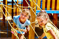 Children move out to slide in playground Royalty Free Stock Photos