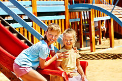 Children move out to slide in playground. Happy children move out to slide in playground Royalty Free Stock Photography