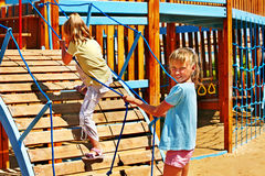 Children move out to slide in playground. Happy children move out to slide in playground Stock Photo