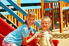 Children move out to slide in playground. Happy children move out to slide in playground Royalty Free Stock Photos