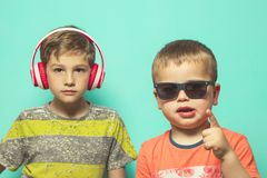 Children with music helmets and sunglasses royalty free stock photography