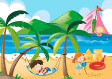 Children napping and playing on the beach Stock Photo