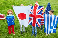 Children with national flags as a symbol of diversity. Children in international kindergarten with national flags as a symbol of diversity royalty free stock photos