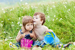 Children nature. Boy and girl in flowers Stock Image
