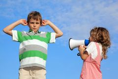 Children on nature, girl shouts in loudspeaker Stock Image